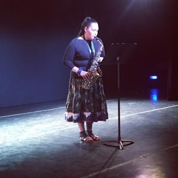 Vonica LaPlante (MHA Nation) performs in front of a packed house at the Off-Broadway Theater at Yale University.